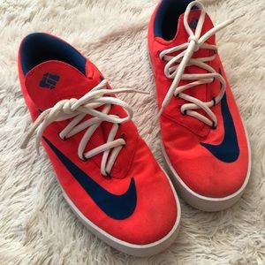 Neon pink and blue Nike KD Vulcan mid sneakers